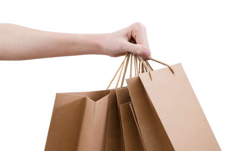 Hand with shopping bags insulated in white background