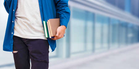 Student with books in hand