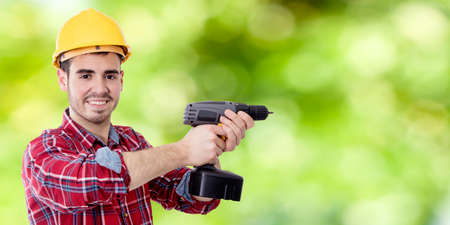 construction worker and bricolage with drill and space for text