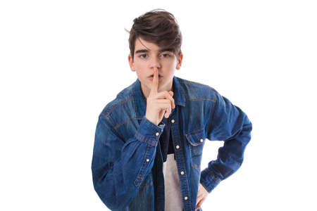young man with gesture of silence isolated in white background Banque d'images - 112603016