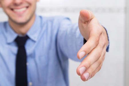 businessman waving smiling
