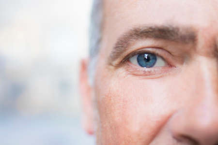 close-up of the adult mans blue eye Stock Photo