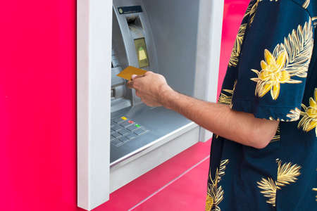 taking money with the card at the bank cashier