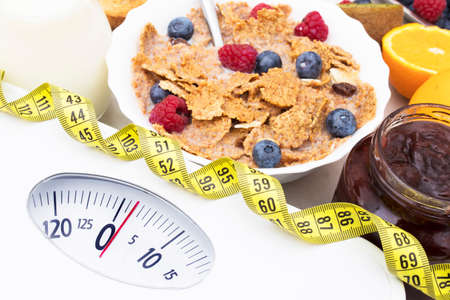 scale with healthy food, diet concept and lose weight