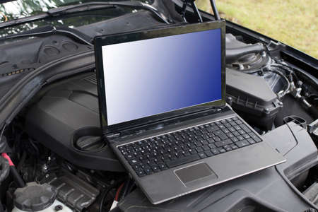 car engine with computer for diagnosis and repair Stok Fotoğraf