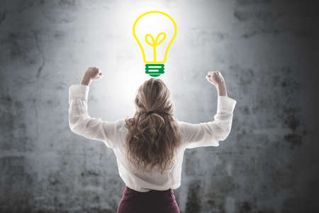 woman celebrating with the symbol of the idea or creativity bulb