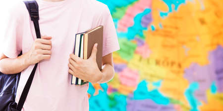 student hand with books and map, learn languages Banque d'images