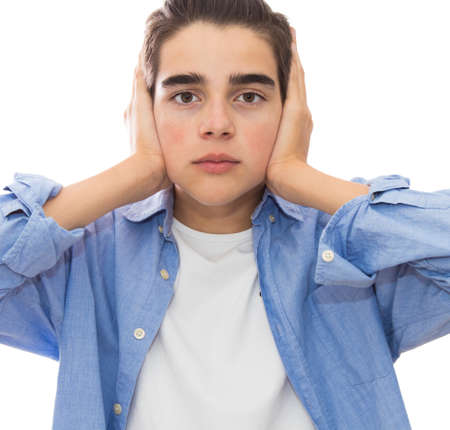 portrait of young isolated covering her ears Stock Photo