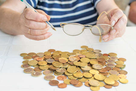old man's hands with heaped money or savings Stock Photo
