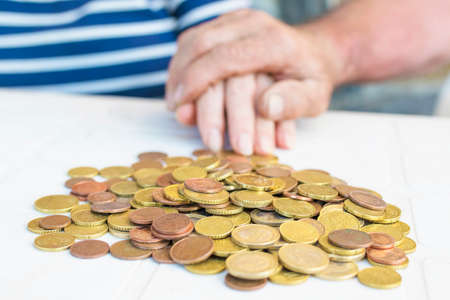 seniors  couple hands with heaped money, pensions and savings Banco de Imagens