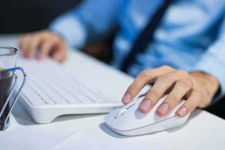 hands with the computer mouse in the office