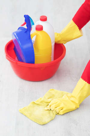 hand with cleaning products scrubbing the floor Standard-Bild
