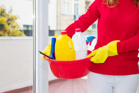 woman with utensils and cleaning products 版權商用圖片