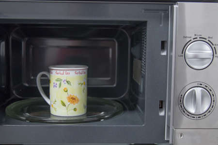 cup in microwave coffee or infusions, heat Imagens