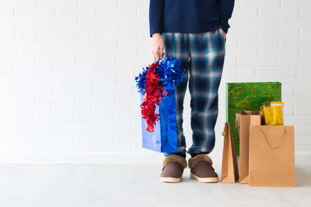 people at home with christmas presents