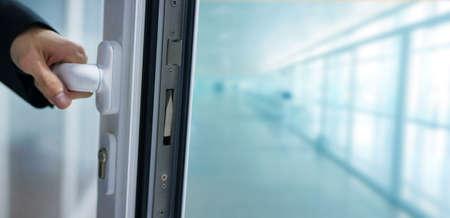 hand opening the office door