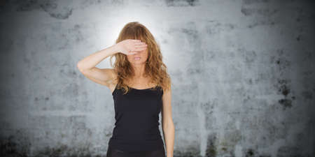 isolated woman covering eyes with her hand Stock Photo