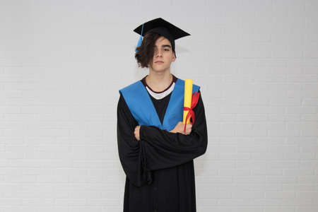 young with diploma and graduation clothes