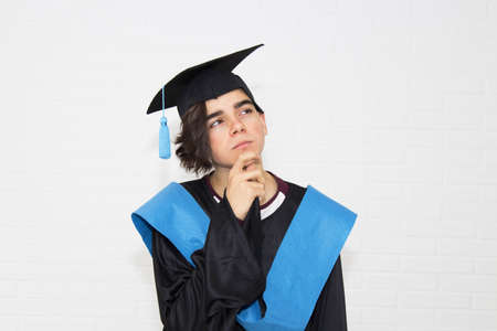 young isolated in a graduation suit