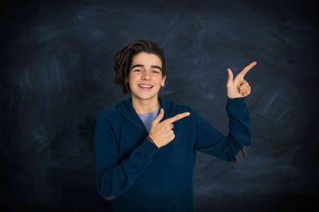 portrait of smiling teenager pointing Stockfoto - 123118587