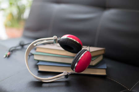 books and headphones on the home sofa