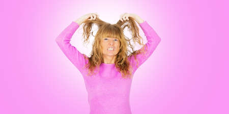 female adult isolated on pink background