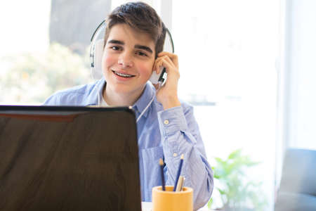 teenage student with computer laptop and headphones Stock Photo