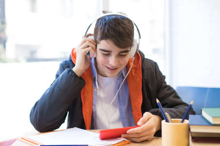 teenager or student with mobile phone and headphones Imagens