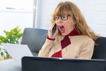 woman with the laptop complaining furious by phone