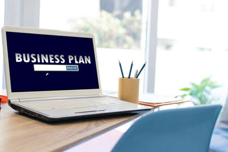 desktop with laptop and business plan concept