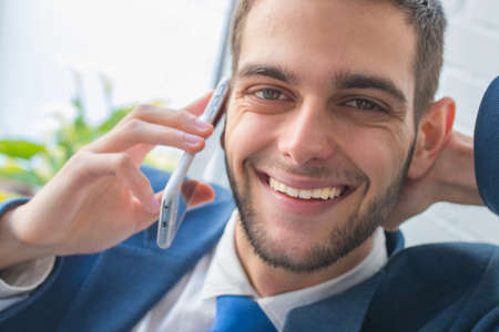portrait of smiling business man with mobile phone