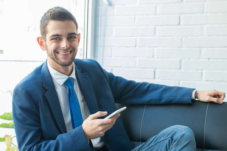 attractive business man with mobile phone Stockfoto