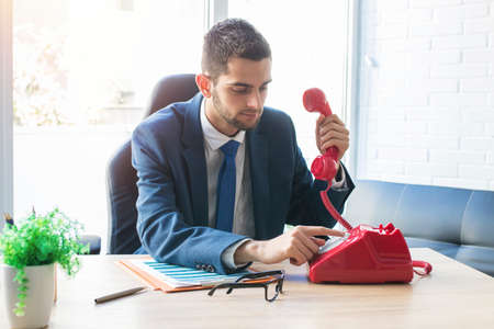 businessman or executive with vintage phone