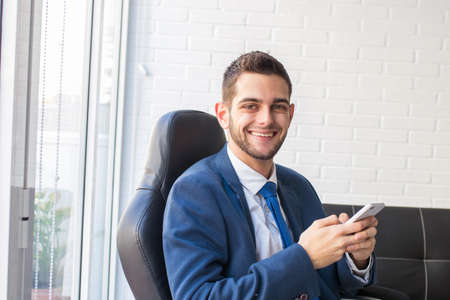 business man in the office with mobile phone Stockfoto