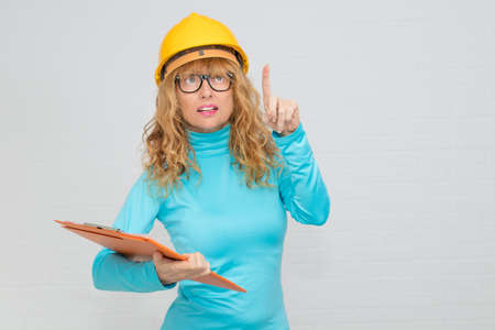 woman with isolated construction helmet Stockfoto