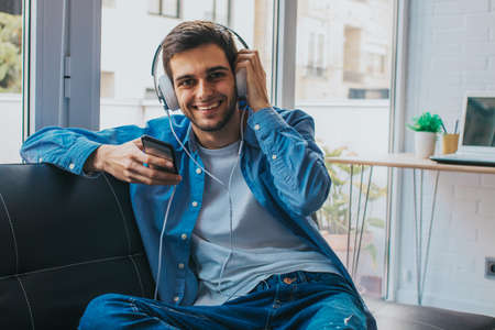 young fashion with phone and headphones