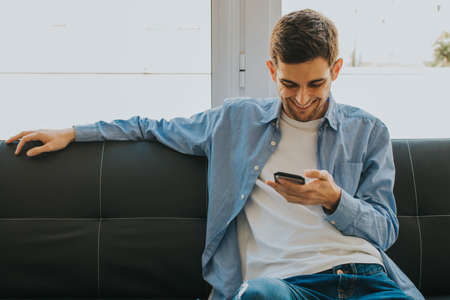 young or teen with mobile phone at home