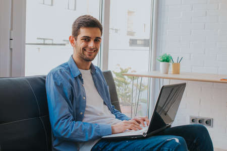 young or student with laptop at home