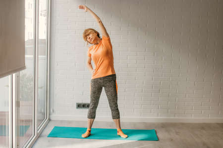 woman athlete exercising at home