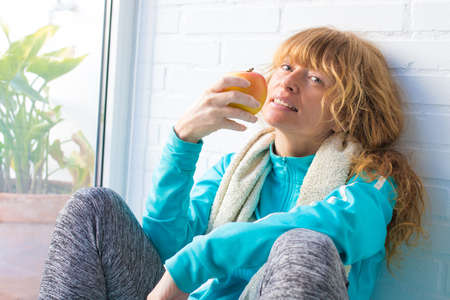 girl athlete resting eating fruit Stock Photo