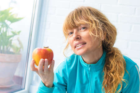 woman athlete with apple, diet and sport