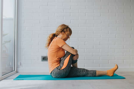 woman doing sports at home or gym Stockfoto
