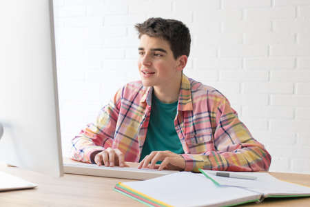 student or teenager with the computer on the desktop