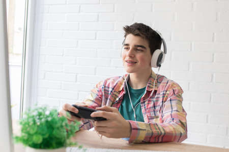 child or young teenager playing with the console