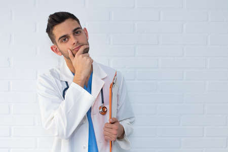 portrait of young doctor with thoughtful expression