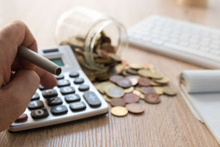 savings concepts with pot and coins