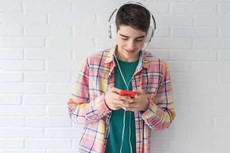 teen with mobile phone and headphones 版權商用圖片