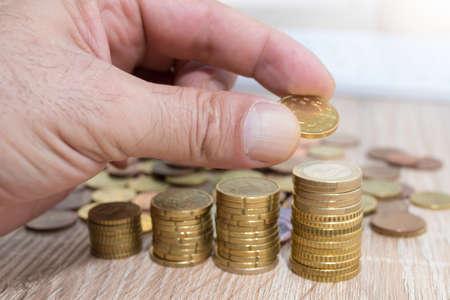 stacked currencies, savings and financial accounting
