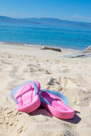 sandals in the sand of the beach, summer and holidays