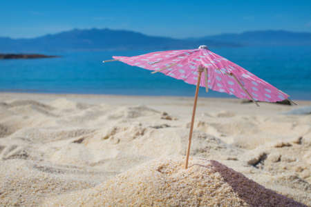 parasol in the sand of the beach, summer and holidays
